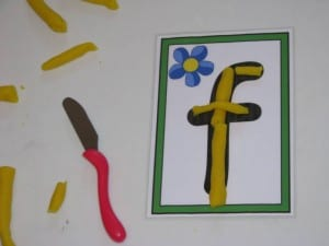Using play dough to make laphabet letters