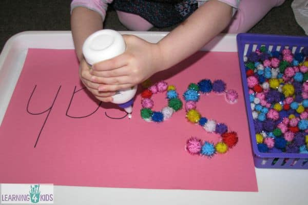 create a name collage with pompoms