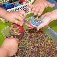 Rainbow rice and bottles tops