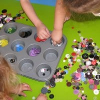 using button for sensory play