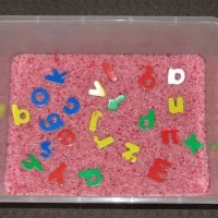 Alphabet hunt using rice for a sensory experience