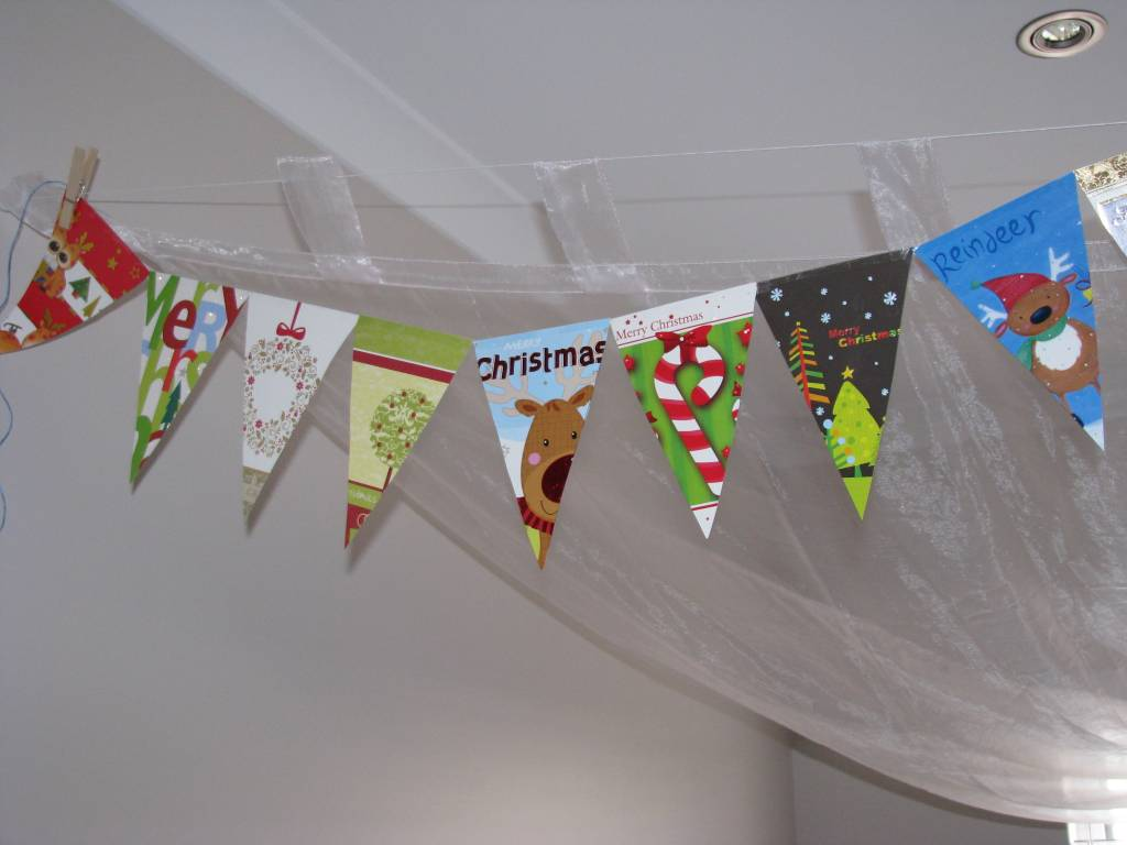 Recycled christmas card garland learning kids