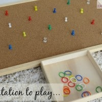 Invitation to play with push pins and elastics bands for fine motor