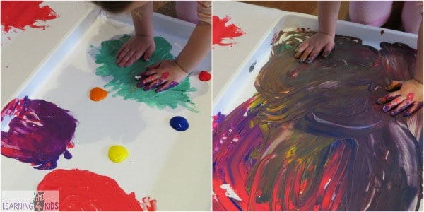 Kids Using Fingers To Paint A Piece Of