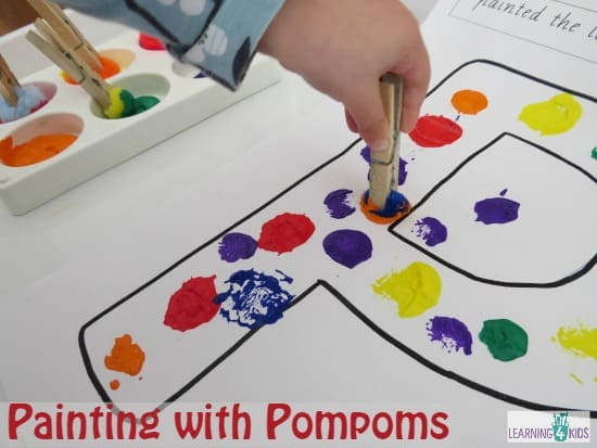 Before painting with the pompoms we ran our fingers inside the shape
