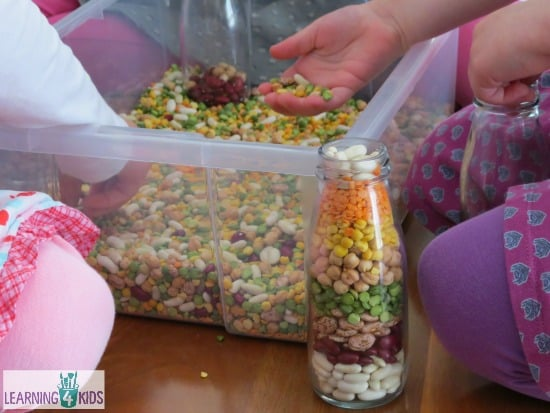 Sensory play with beans and pea mix