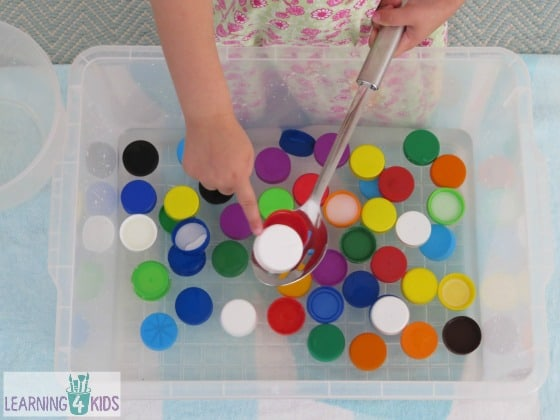 Scooping up coloured bottle tops