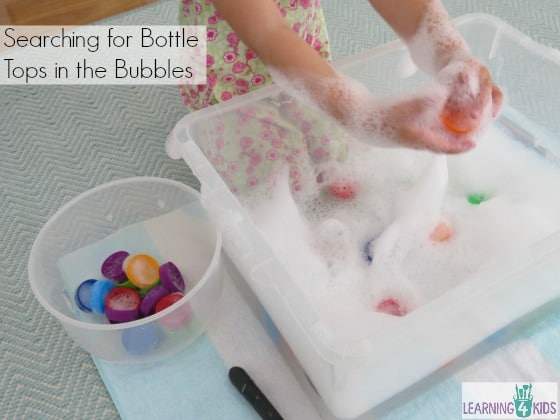 Sensory play for toddlers and kids - bubbles and bottle tops