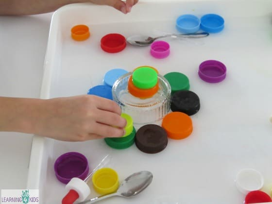 Creative Play with bottle tops, water and eye droppers
