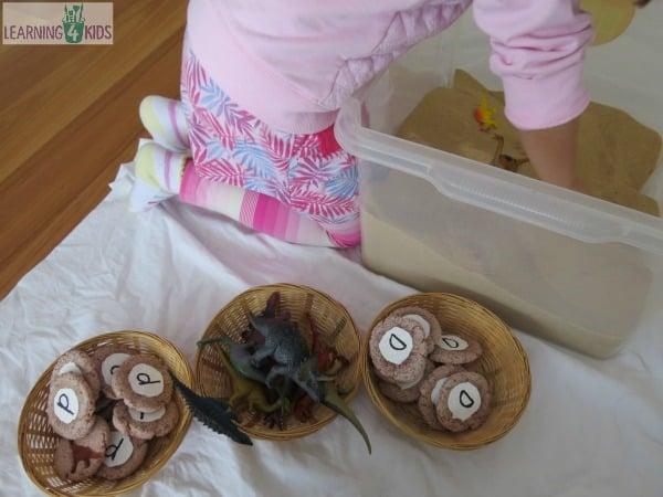 Dinosaur digging activity in a sensory bin