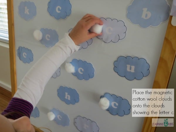 Place the magnetic cotton clouds onto the letter c