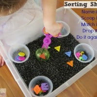Sorting shapes activity using a sensory bin and scooper scissors by learning 4 kids