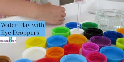 Water play with eye droppers encourages pincer grasp by learning 4 kids