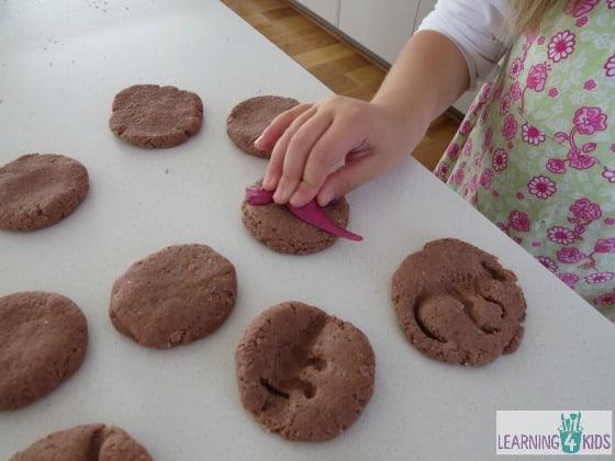 how to make dinosaur fossils - press dinosaur figurine gently into salt dough