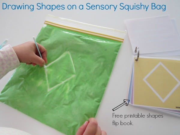 Drawing shapes on a sensory Squishy bag with free printable shapes flip book
