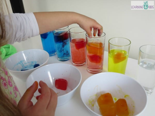 Mixing primary colours activity using melting coloured ice blocks