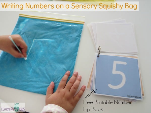 Writing Numbers on a Sensory Squishy Bag with free printable number flip book