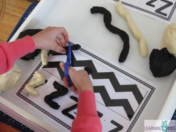 Learnin about the letter z using free printable zig zag zebra play dough mats and play dough