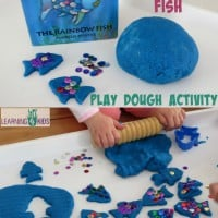 The Rainbow Fish by Marcus Pfister inspired activity - using play dough and sequins to re-create the story