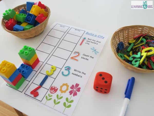 Build a city counting and subitising game using dice and blocks