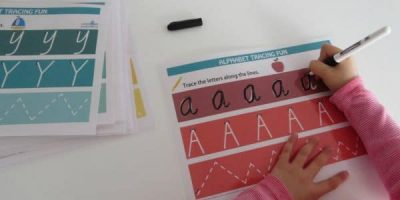 Printable alphabet letter tracing mats available in 2 fonts. Fun rainbow theme.