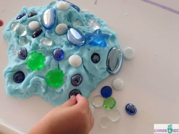 Rubbery Goop play opportunity with glass gems