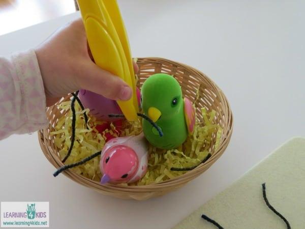 Fine motor activity for kids using tweezers
