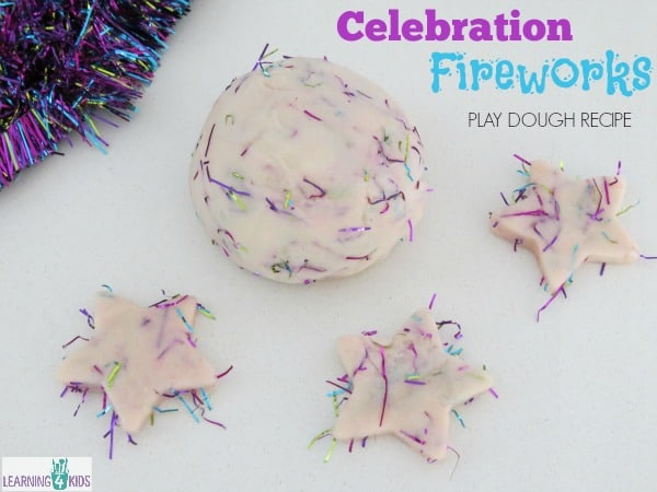 Celebration Fireworks play dough recipe - adding tinsel to create a fireworks affect as fireworks are