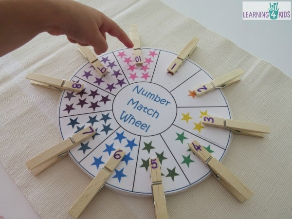 Counting out loud and number recognition activity - free printable number match wheel