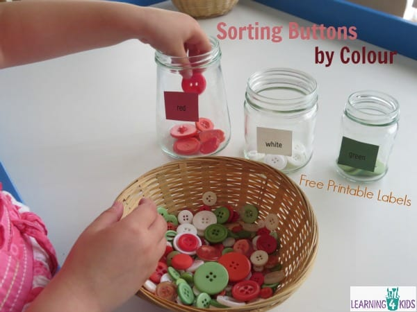 Sorting buttons by colour - colour recognition activity for kids.  Free printable labels