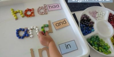 Build a sight word using wooden alphabet letters and glass gems. Free printable sight word cards.