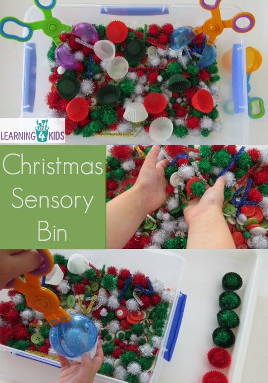 Christmas sensory bin filled with pompoms, pipe cleaners, buttons and cupcake cases.