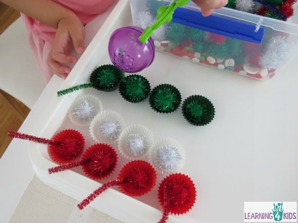 Christmas sensory tub and fine motor fun activity.