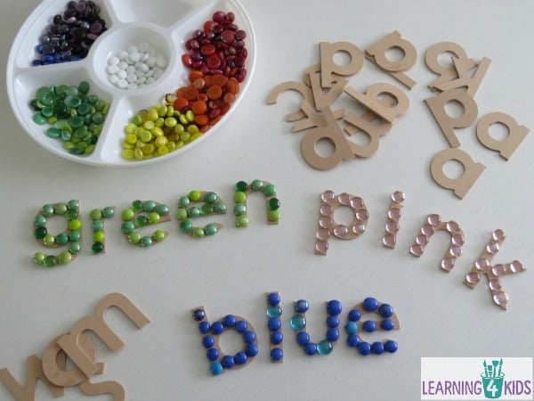 Colour activities - creating colour words using wooden letters and coloured glass gems.
