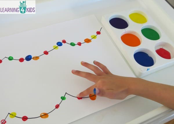Creating festive or Christmas lights with finger paint.  simple christmas painting activity.