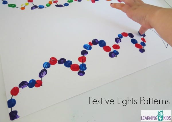 Creating patterns with finger paint - Festive Lights Painting