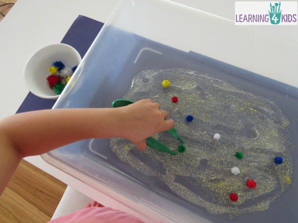 Fine motor fun with fireworks theme sensory tub.