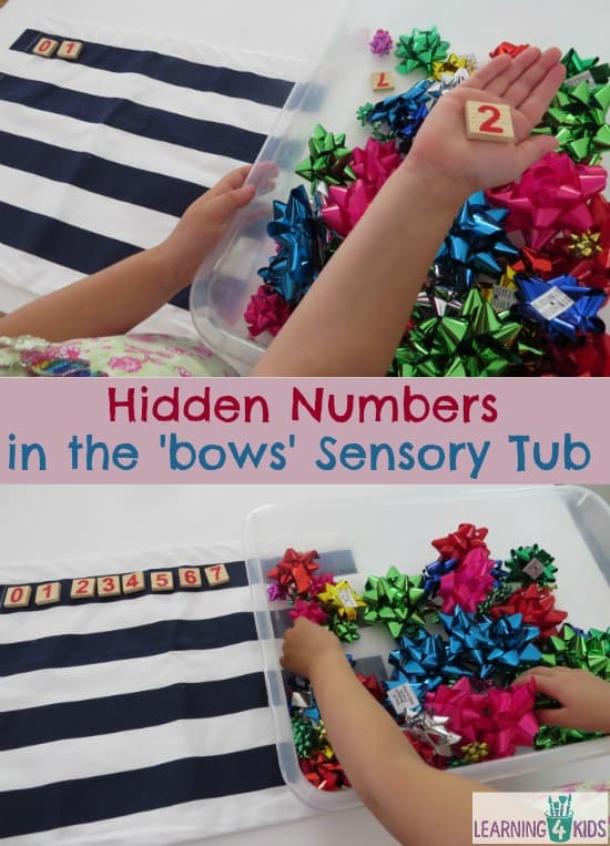 Fireworks (bows) maths theme activity - hidden numbers in a fireworks sensory tub.