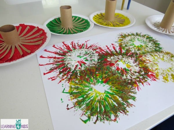 Fireworks celebration activity - painting fireworks with paint and cardboard rolls.