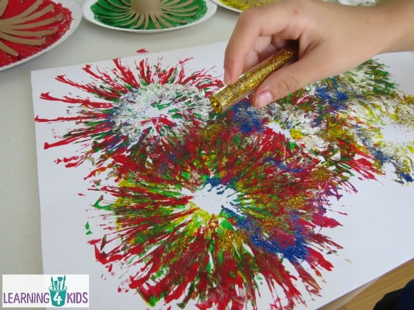 Fireworks celebration painting with glitter.
