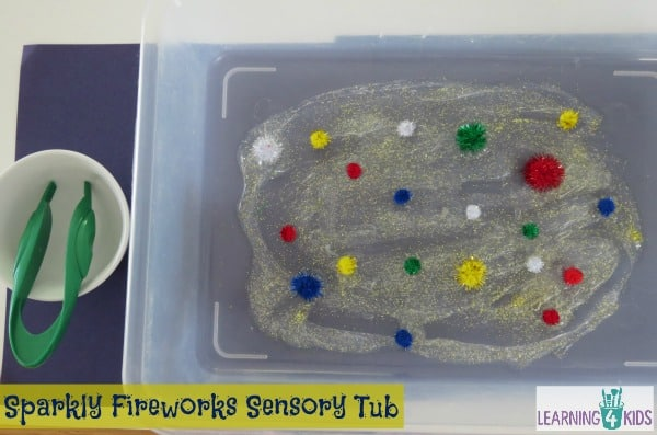 Invitation to play with sparkly firework sensory tub