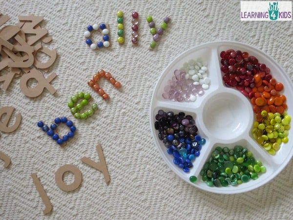 Name activities - making names using large wooden letters and glass gems.  super fun.