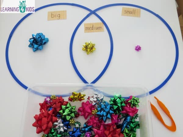 Sorting activity with bows - classifying into groups of big, medium and small.  Measurement activity.
