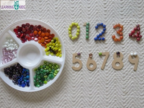 number recognition and number sequence activity using wooden numbers and glass gems