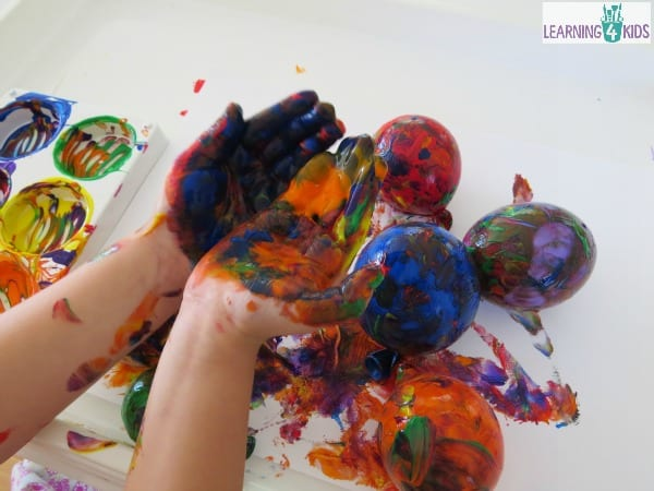 Sensory paint play idea - painting and exploring with balloons