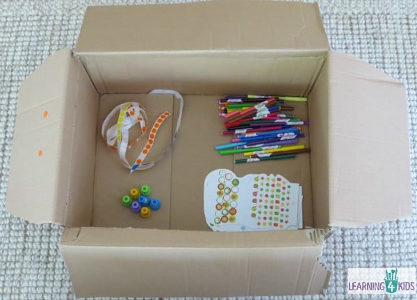 cardboard box creativity - add stickers, stamps and textas.  anything really.