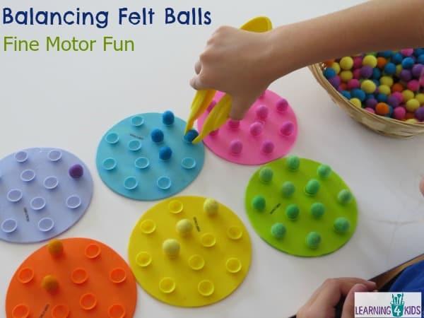 Balancing Felt Balls Challenge for fine motor fun and coordination.