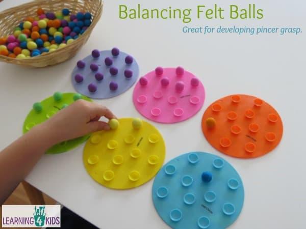 Balancing felt balls - great for developing pincer grasp