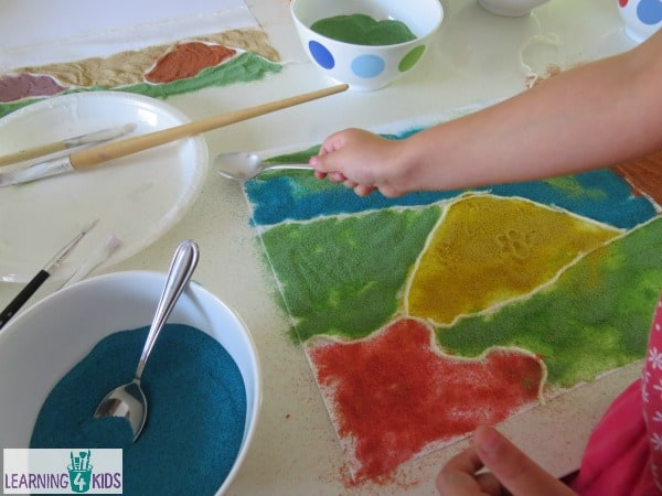 Exploring colours using sand - creative art inspired by Magic Beach by Alison Lester