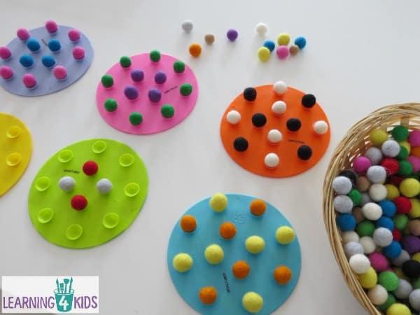 making patterns with felt balls - fine motor activity balancing felt balls